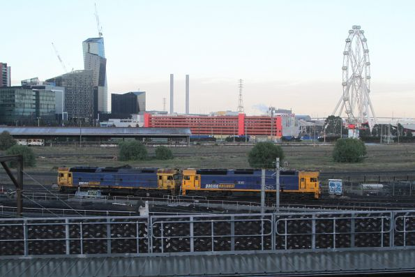 BL34 and G541 head light engine between a broad gauge steel train at Melbourne Freight Terminal and South Dynon