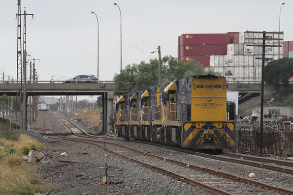 Indian Pacific liveried NR86 leads NR87, NR21, NR61 and IP liveried NR26 on the up from UGL Spotswood to Dynon at Brooklyn