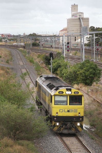 QBX001 heads north through Sunshine on a light engine move to Seymour