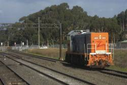 T386 heads light engine through Lara, bound for level crossing testing out west