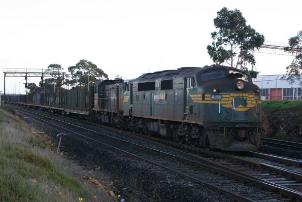 A78 departing North Geelong Yard on the up with a rake of empty log flats