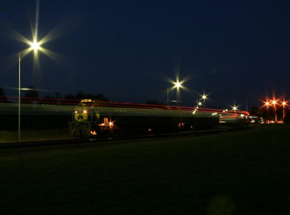 Tail lights streak past on the passenger train