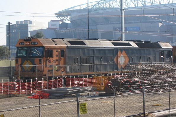 BL34 leads a down steel train through Spencer Street Station