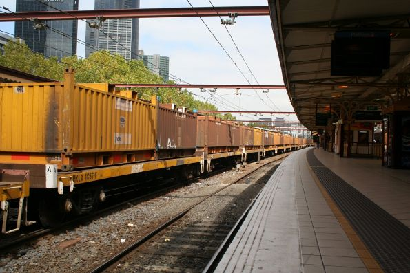 RKLX wagons roll by, no one standing on platform 9