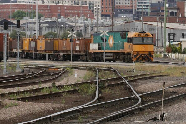 Trailerail liveried NR53 shunts standard gauge wagons out of the storage roads at the Melbourne Steel Terminal