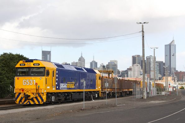 Freshly overhauled G531 shunts SG wagons at the Melbourne Steel Terminal