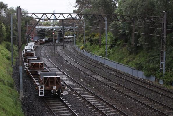 Recently converted jumbo coil wagons trail the up steel train at South Yarra