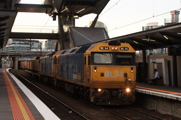 BL34 and classmate leads the up steel train through North Melbourne platform 6