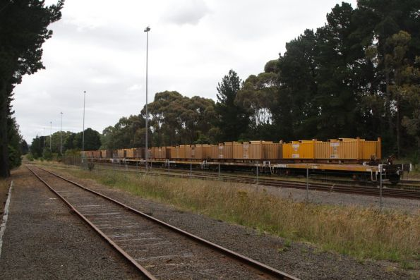 'Butterbox' coil steel wagons sit in the sidings beside Bayview Road