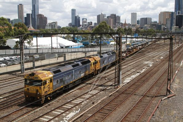 BL34 and BL29 lead a mix of open coil steel wagons and 'butterbox' containers through Richmond Junction on the down