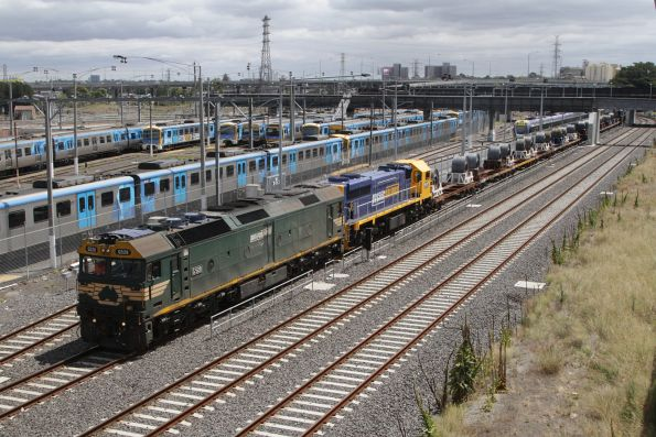 G528 and XR551 leads the down steel train past North Melbourne station