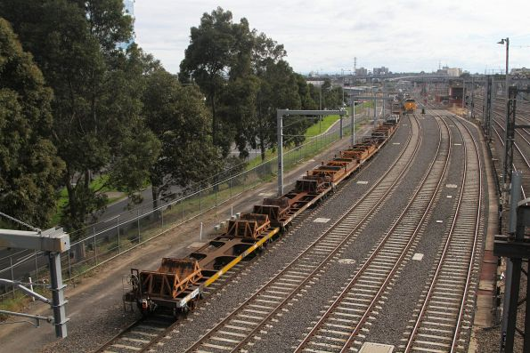 Tail end of the up steel train is fouling the points at Melbourne Yard, preventing the down steel train from passing