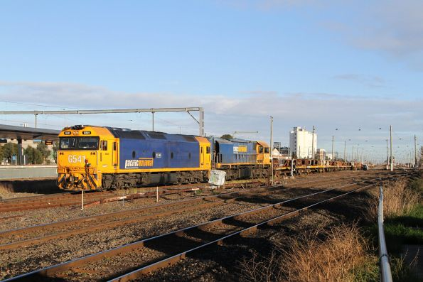 XR559 and G541 depart Tottenham Yard with an empty rake of coil steel wagons