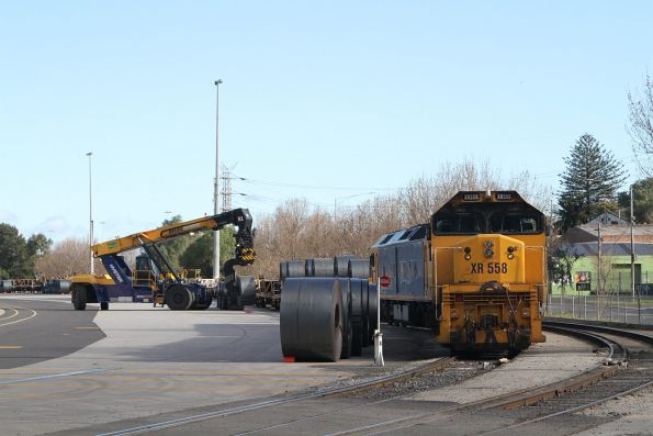 XR558 and G541 wait for their train to be loaded with coil steel at the Melbourne Freight Terminal