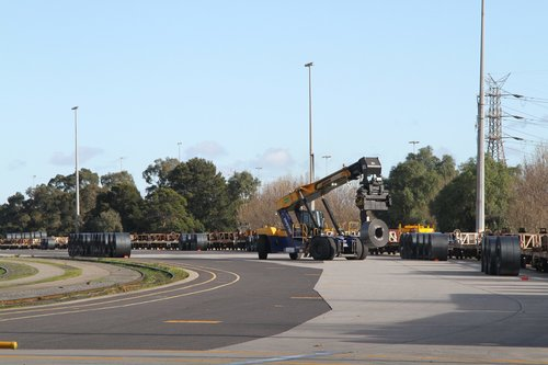 Reach stacker at work loading the train with coil steel at the Melbourne Freight Terminal
