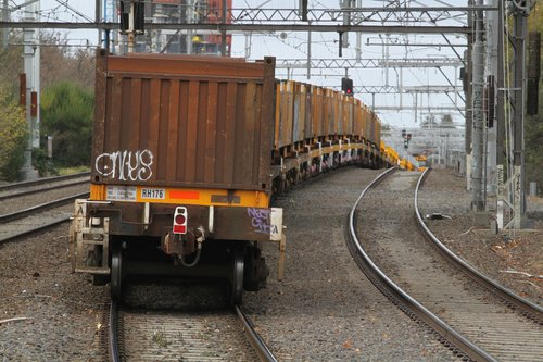 'Butterbox' containers trailing a load of coil steel on the down journey