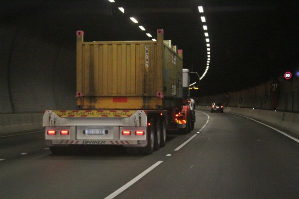 Saturday, 19 May - Semi trailer carries a single 'butterbox' steel container citybound through the Domain Tunnel