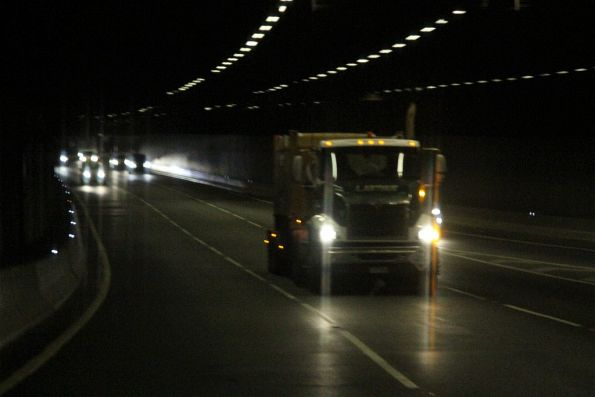 Semi trailer carries a single 'butterbox' steel container citybound through the Domain Tunnel