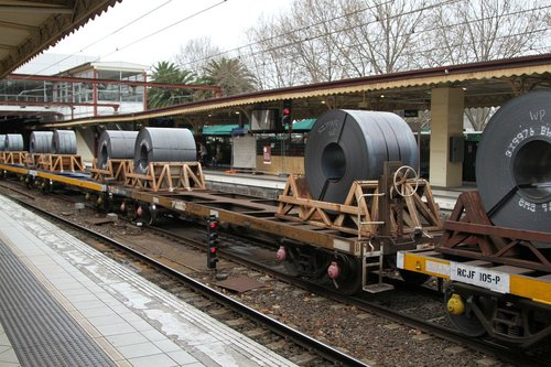 Coil steel wagons leading butterbox containers on the down Long Island steel train