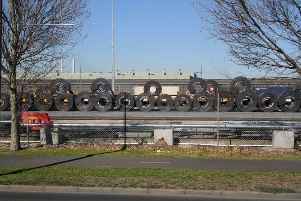 Row of coil steel beside the transhipping sidings at the Melbourne Freight Terminal