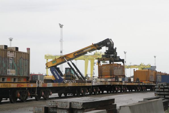 Moving 'butterbox' steel containers from broad to standard gauge at the Melbourne Freight Terminal