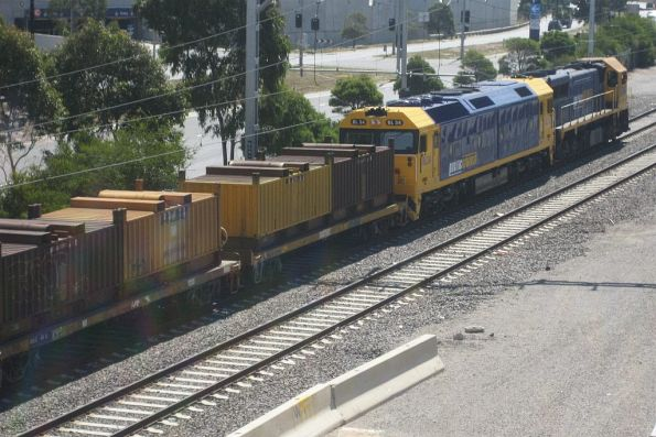 XR551 leads BL34 on the up at Southern Cross with 'butterbox' coil steel containers