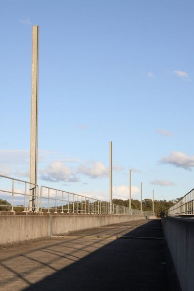 Stanchions for overhead electrification along the bridge