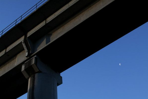 The moon comes out under the bridge