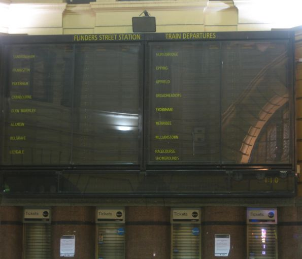 It's 1:08 AM and the Solari board at Flinders Street Station is displaying no trains