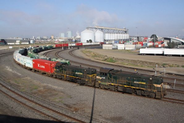 P22 and P20 stabled with a container freight at Appleton Dock, cement hoppers on the track alongside
