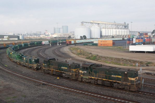 P22 and P20 stabled at Appleton Dock, a rake of cement hoppers behind
