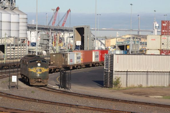 A79 on the end of a rake of container flats at Appleton Dock