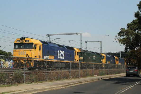 G522, G528, G536 and BL29 depart West Footscray on the up with a pair of empty container wagons from Tottenham Yard