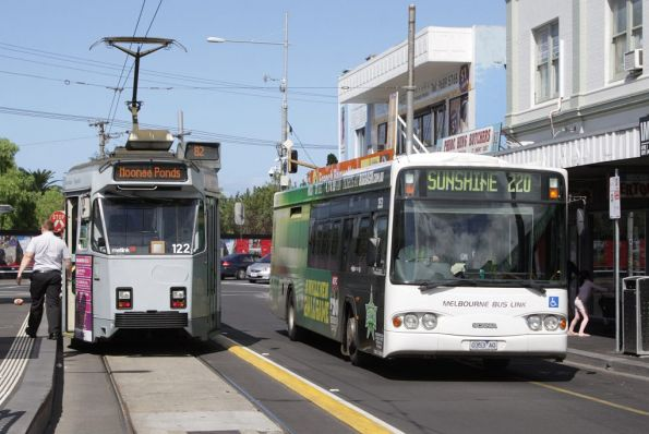 Melbourne Bus Link #353 0353AO on a route 220 service passes Z3.122 at the Footscray tram terminus