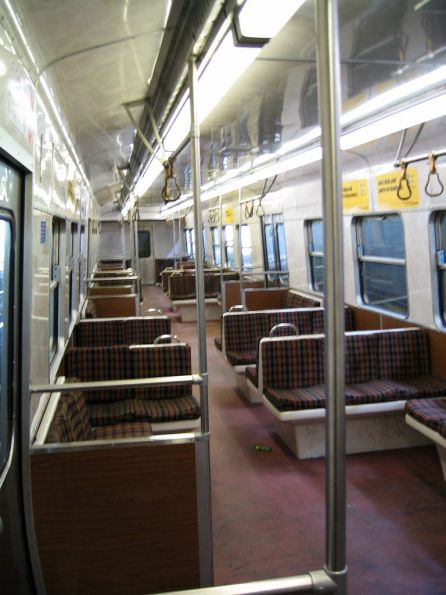 Older style Hitachi interior - red linoleum floor and bare metal grab poles