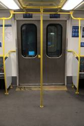 Additional grab poles inside the doors of Connex-era modified Comeng 541M