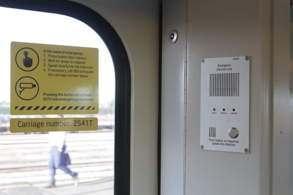 Relocated emergency intercom signage onboard a Siemens train