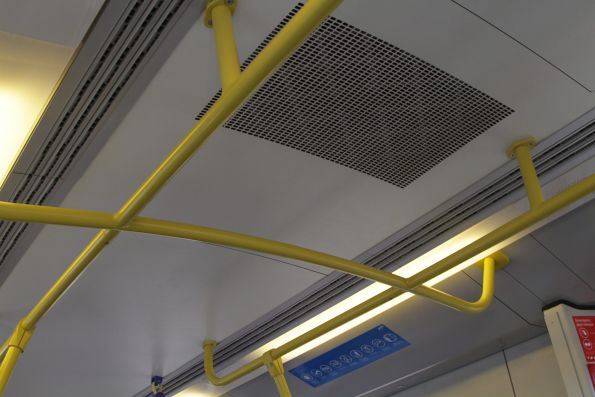 Additional overhead handholds around the doorways of a Siemens train