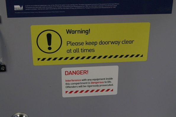 New font used in the 'Warning! Please keep doorway clear at all times' signage onboard an X'Trapolis train