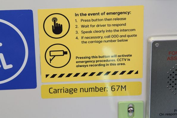 New style 'in the event of emergency' sticker onboard an X'Trapolis train