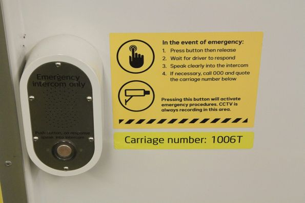 New style 'in the event of emergency' sticker onboard a Comeng train