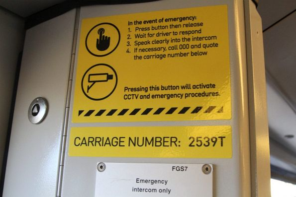 Early style 'in the event of emergency' sticker onboard an X'Trapolis train