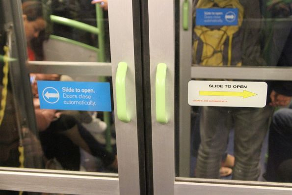 New and original style 'Slide to open' stickers on the intercarriage doors of an X'Trapolis train