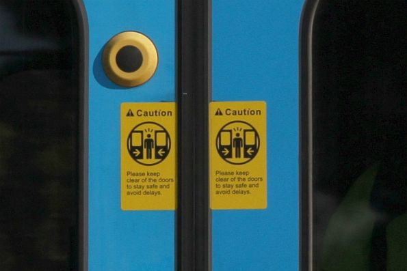'Caution: Please keep clear of the doors to stay safe and avoid delays' stickers added to a Siemens train