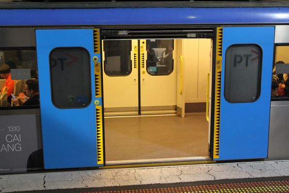 Another style of 'Do not approach closing doors' stickers on the doors of Siemens train 791M-792M