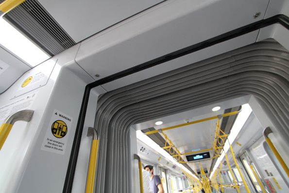 Fire doors in the normally open position at the end of a dMP carriage of a HCMT set