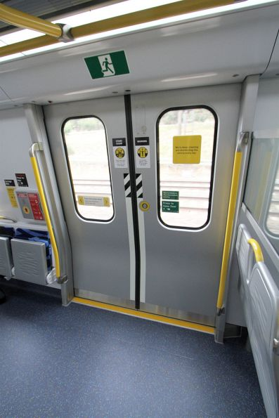 'Stand clear' signage on the doors onboard a HCMT set