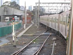Up Upfield Hitachi passing the North Melbourne end of the Arden Street sidings