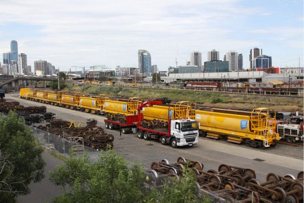 Eight of Metro's CHOYs wagons and the genset wagon at the Creek Sidings. The truck is loading bogies