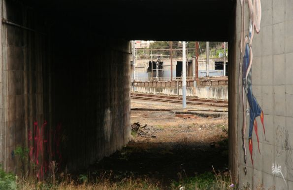 Looking north under the Departure Track underpass, tracks long since removed